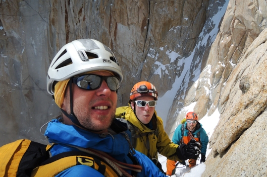 Domen, Tim and Sam already high up on the ledges exiting the couloir