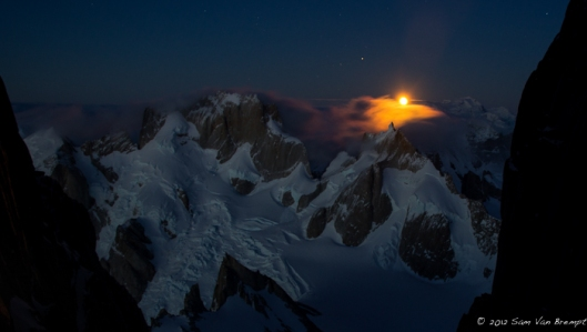 The moon sets above Cerro Pollone while sun is rising