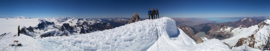 Tim on the left, the Brits on the summit of Cerro Torre. Fitz Roy and the Pampa in the back