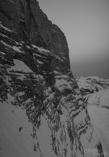 Maxime climbing on the lower part of Eiger's North Face. Stollenloch a bit lower in the back