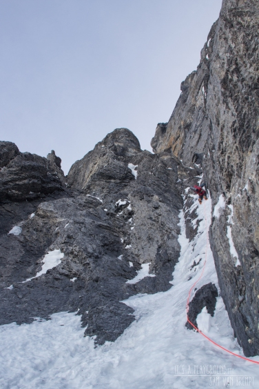 Maxime climbing the direct gully to the Quartz Crack