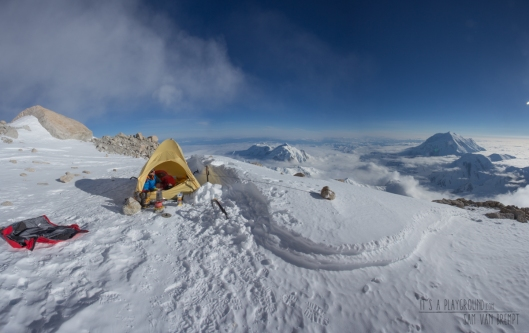 Maxime resting out at 17000ft on Denali's West Rib. Mt Hunter and Foraker in the back