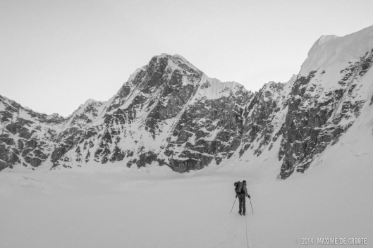 Sam approaching Kahiltna Queen, The west face couloir is the obvious snow line starting in the middle of the face and leading up to the righthand ridge