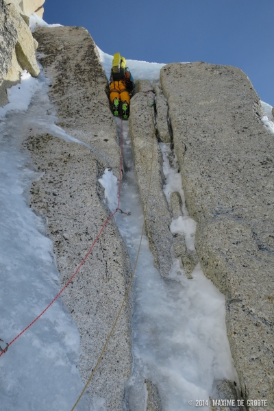 Sam climbing the last hard pitch, we're still wondering if this or the lefthand ice smear is the original route