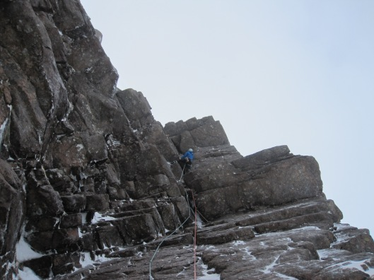 Dave has just overcome a small roof and has come to the crux of the route, a delicate traverse. Denis (c)