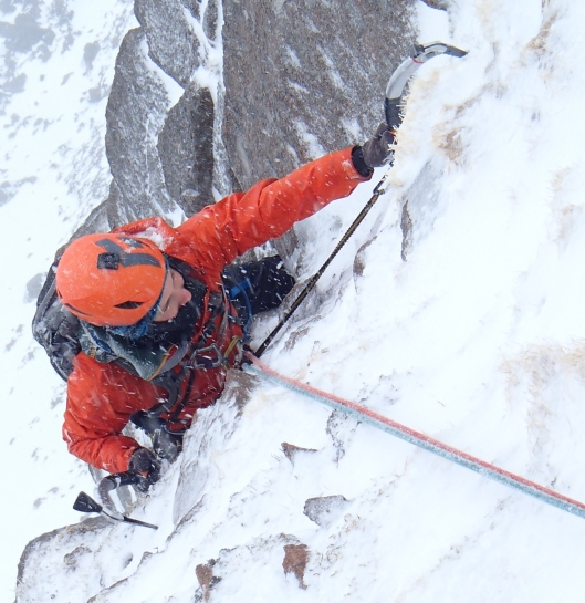 I love turf! Arriving at the belay high up on 'Route Major', IV, 5. Dave (c)
